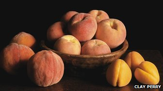 New large early apricot on ground with peregrine peach in bowl