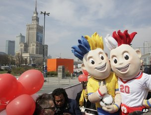 Euro 2012 mascots Slavek, right, and Slavko pose in front of the Palace of Culture in Warsaw, Poland, 20 April