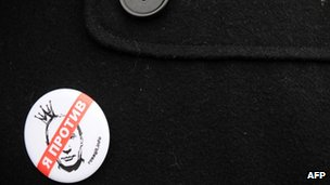 A protester on Red Square Moscow, 1 April 2012, wears a badge featuring Vladimir Putin in a crown and saying &quot;I object&quot;