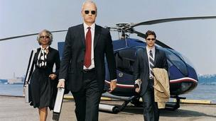 Business people walk away from a helicopter