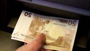 Euro notes at an ATM