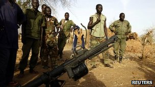 SPLA-N fighters stand in front of a captured grenade launcher near Gos village in Nuba Mountains in South Kordofan, 1 May  2012.