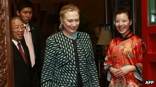 US Secretary of State Hillary Clinton proceeds to a dinner with State Councilor Dai in Beijing