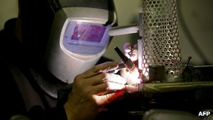 Welder working on a London 2012 Olympic torch