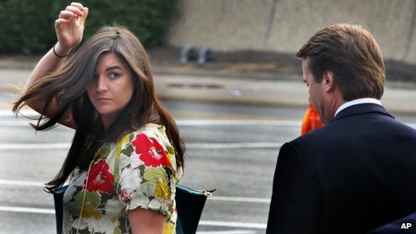 Cate Edwards looks back at her father, John Edwards, as they leave court in Greensboro, North Carolina, on 2 May 2012