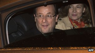 Francois Hollande and his partner Valerie Trierweiler leave by car after the debate in Paris, 2 May