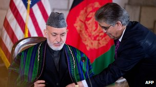 President Karzai signs the US-Afghanistan strategic partnership agreement
