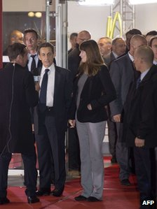 Nicolas Sarkozy leaves the debate studio in Paris with his wife Carla Bruni, 2 May