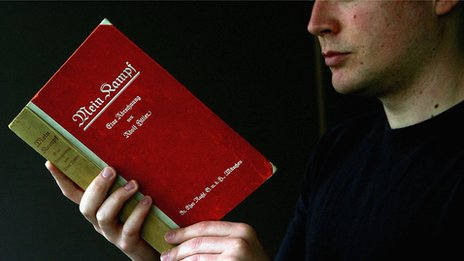 Man reading Mein Kampf