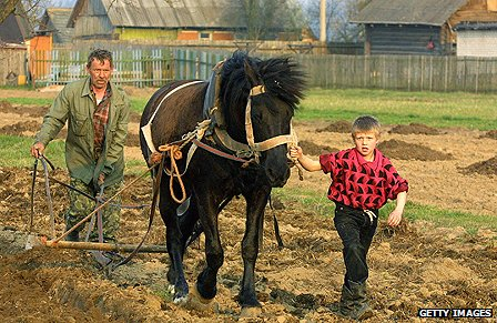 Farmer ploughing a field in Belarus