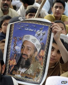 A boy holds a poster of Osama Bin Laden in Quetta, Pakistan, on 2 May 2012