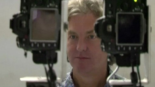Cameras in front of James May
