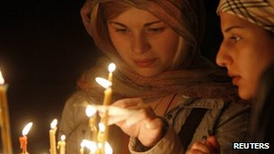 Women light candles during an Orthodox Easter service at the Sioni cathedral in Tbilisi