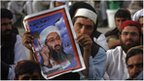 A man holds a poster of Osama Bin Laden at a rally in Quetta, Pakistan, 2 May 2012