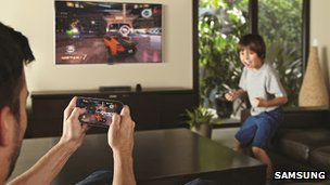Family playing video game on its television through wireless connectivity