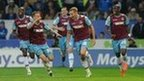 West Ham's Welsh midfielder Jack Collison wheels away in delight after giving his side the lead in the first leg of their Championship play-off semi-final at Cardiff City