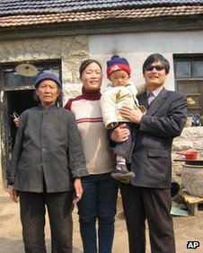 Handout picture from China Aid Association of Chen Guangcheng, with his son, Chen Kerui, his wife Yuan Weijing, and his mother in Shandong province, China, undated