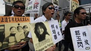 Activists outside the China's Liaison Office in Hong Kong 30 April, 2012