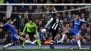 Papiss Cisse of Newcastle scores against Chelsea