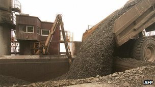 A truck unloads freshly excavated rock into a crusher at a copper mine in Indonesia