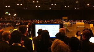 Huddling round the adjudication screen at the Glasgow count