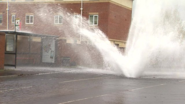 Water spraying from a burst water pipe in Gateshead