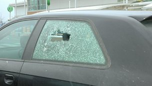 car with bullet hole in window