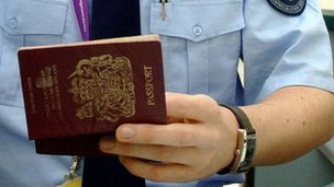 Immigration officer checking a passport