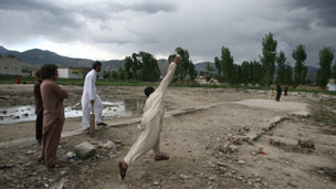 Cricket on the site of the demolished Bin Laden compound