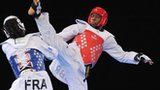 Lutalo Muhammad competes against France's Augustin Bata during the men's -87kg final at the 2012 European Taekwondo Championships in Manchester