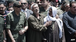 "Egypt's military ruler, Field Marshal Mohamed Hussein Tantawi (L) attends the funeral of a member of Egypt""s special forces in Cairo on May 5, 2012"
