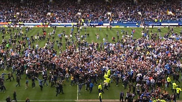 The Sheffield Wednesday fans take to the Hillsborough pitch