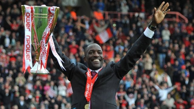Charlton manager Chris Powell celebrates with the League One trophy