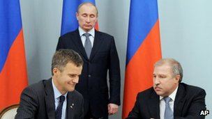 "Russian Prime Minister and President-elect Vladimir Putin, Norway""s Statoil Chief Executive Helge Lund, left, and Rosneft president Eduard Khudainatov"