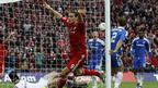 Andy Carroll celebrates, but his goal is ruled out