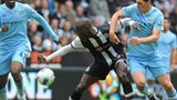 Demba Ba and Gareth Barry battle for possession