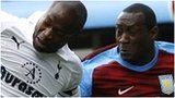 William Gallas tussles with Emile Heskey