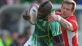 Jamba Ulengo of South Africa is tackled by Ifan Evans of Wales