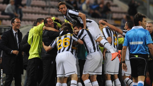 Juventus celebrate scoring against Cagliari - their win sealed the Serie A title