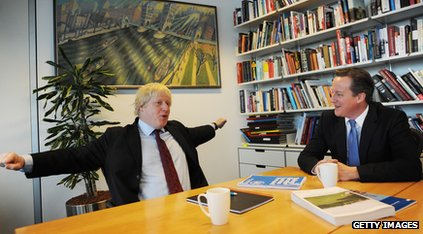 Boris Johnson and David Cameron chatting in an office