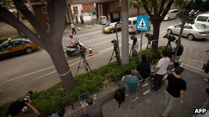 Foreign media gathered in a police cordon outside the hospital where blind Chinese activist Chen Guangcheng is receiving treatment in Beijing on 7 May, 2012