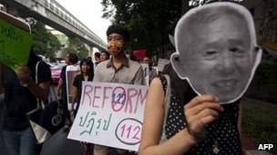 Thai activists stage a march against the country&#039;s widely-criticised laws protecting the monarchy, in Bangkok on 10 December, 2011