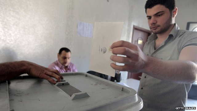 Voter in Syria