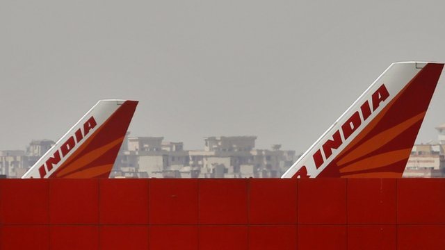 Air India planes park at Indira Gandhi International Airport in New Delhi, India