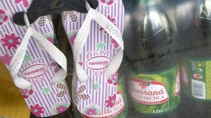 Havaianas sandals and guarana drink in window of Emporio Brazil shop
