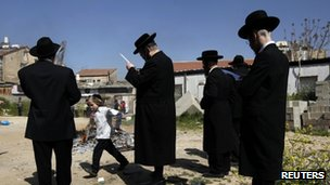 Ultra-Orthodox Jewish men pray as they burn leaven in the Mea Shearim neighbourhood of Jerusalem, ahead of the Jewish holiday of Passover, April 6, 2012.