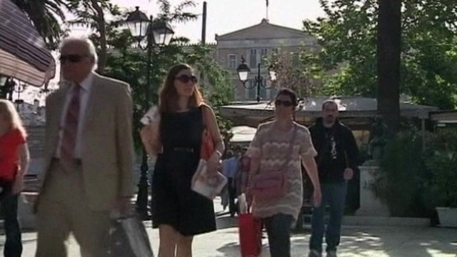 People walking in front of Greek parliament building