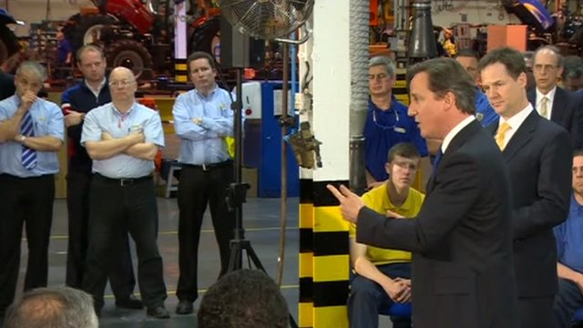David Cameron and Nick Clegg talking to tractor factory workers