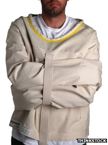 A stock photo of a man in a straight jacket