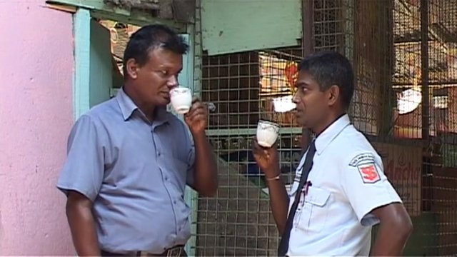 Two Sri Lankans drinking tea